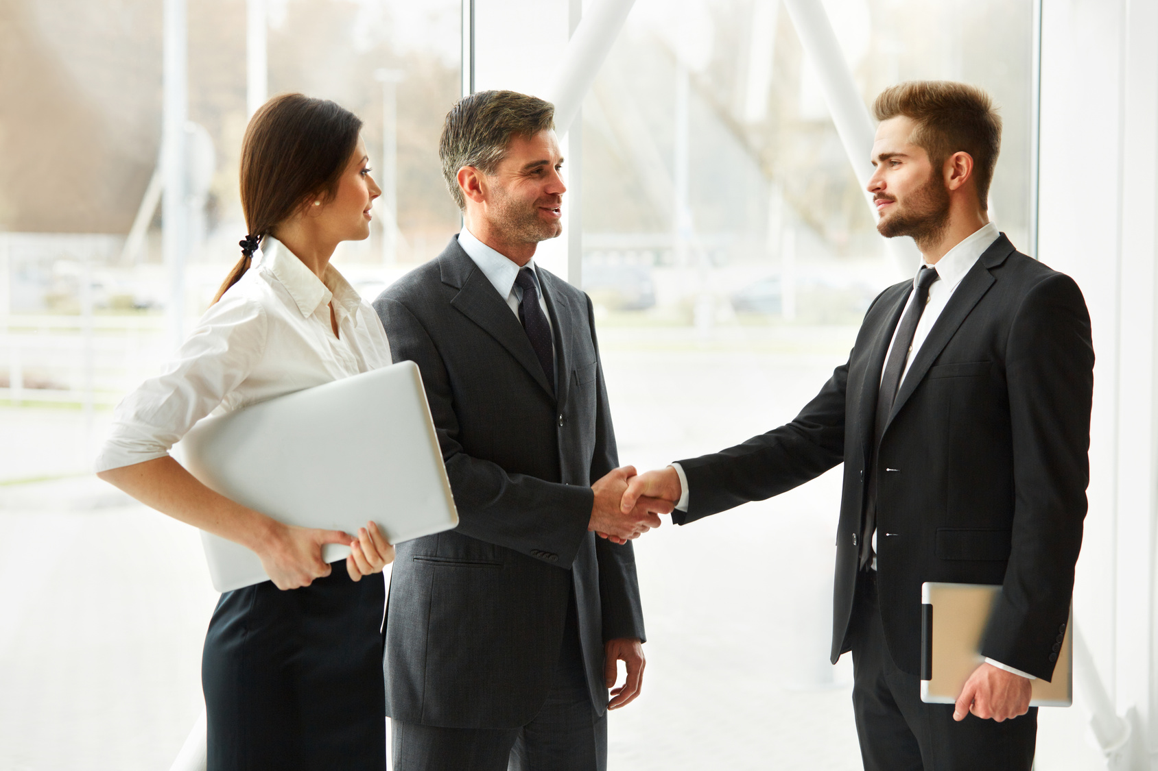 business people successful business partner shaking hands in th